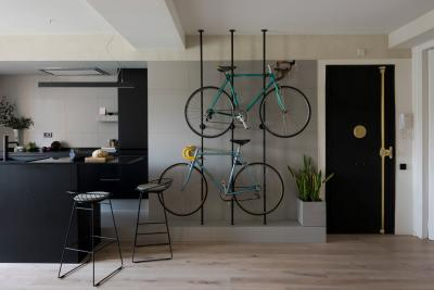 Apartment renovation in Barcelona features bespoke bicycles storage